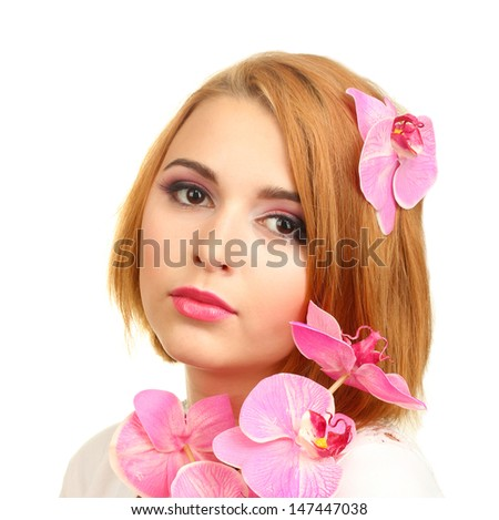 portrait of sexy young woman with pink orchid flower - stock photo