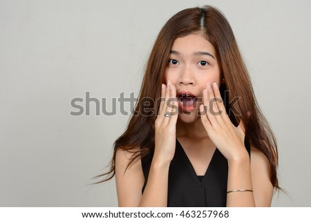 Portrait of shocked Asian teenager girl