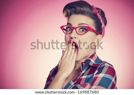 Portrait of shocked pin-up girl    - stock photo