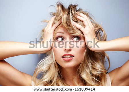 Portrait of shocked woman - stock photo