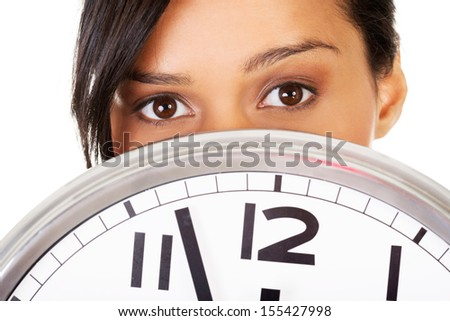 Portrait of shocked woman with clock over white background - stock photo