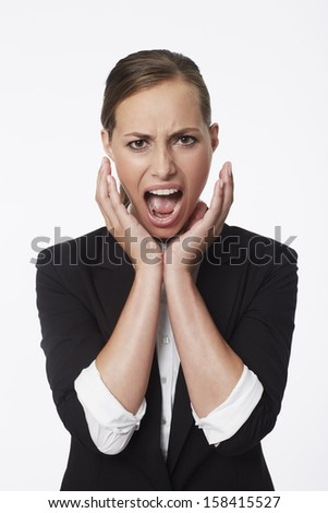 Portrait of shocked young businesswoman