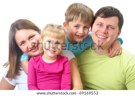 Portrait of siblings and their parents looking at camera