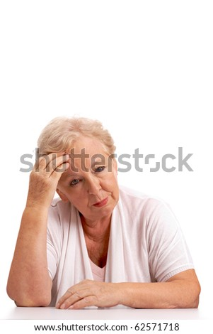 Portrait of sick aged woman touching head and looking at camera
