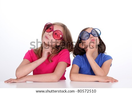 Portrait of sisters being imaginative - stock photo