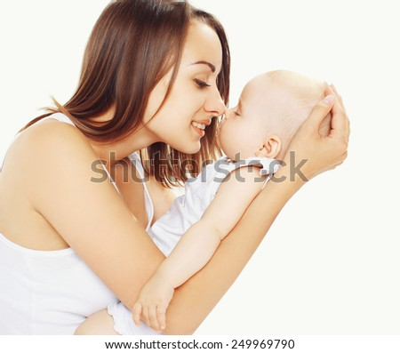 Portrait of sleeping baby on hands his mother - stock photo