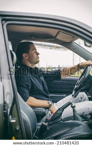Portrait of sleeping handsome man in the car. - stock photo