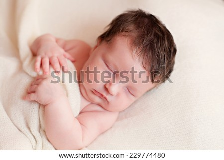 Portrait of  sleeping newborn baby girl - stock photo