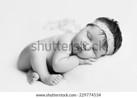 Portrait of  sleeping newborn baby girl bw - stock photo