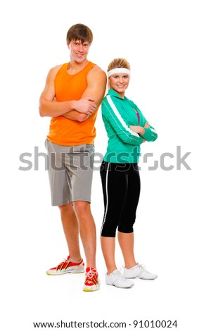 Portrait of slim girl and man in sportswear isolated on white