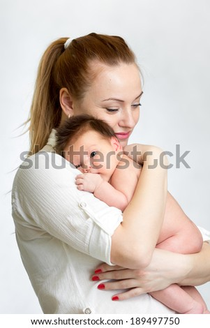 Portrait of small baby and his mother - stock photo