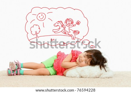 Portrait of small girl lying and dreaming about riding a horse - stock photo