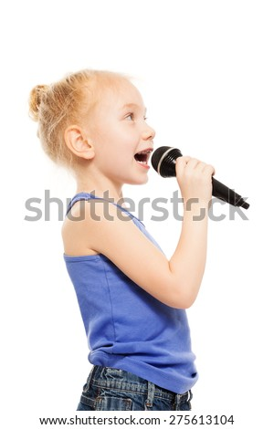 Portrait of small girl singing in microphone - stock photo