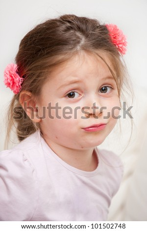 Portrait of small girl with chickenpox making funny face - stock photo