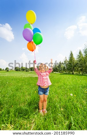 Portrait of small girl with colorful balloons