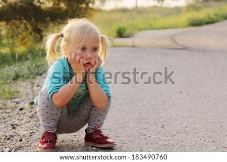portrait of small sad girl - stock photo