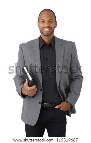 Portrait of smart black businessman smiling with personal organizer handheld, isolated on white.