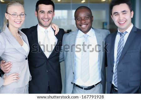 Portrait of smart business group standing in row and looking at camera with smiles - stock photo