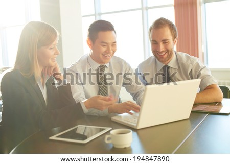 Portrait of smart business partners networking at meeting - stock photo