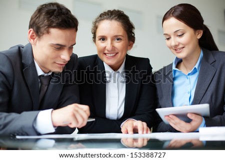 Portrait of smart business partners working together in office