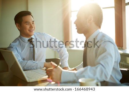 Portrait of smart businessmen discussing new ideas at meeting