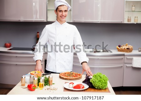 Portrait of smart chef preparing delicious meal for customer