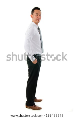 Portrait of smart Chinese Asian business man smiling with hands inside pocket isolated on white background