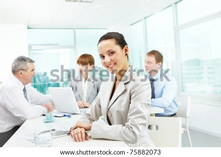 Portrait of smart employer looking at camera in working environment - stock photo