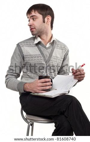 Portrait of smart fun young male executive sitting on chair isolated against white background, - stock photo