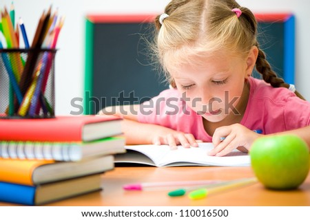 Portrait of smart girl at workplace - stock photo