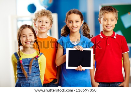 Portrait of smart schoolkids standing in line and looking at camera - stock photo