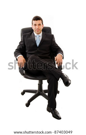 Portrait of smart young businessman sitting on chair isolated against white background