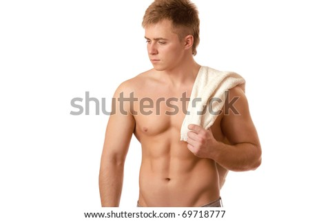 Portrait of smart young muscular man posing against white background - stock photo