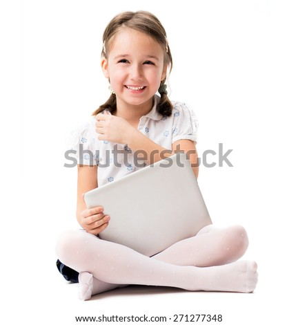 Portrait of smile young girl with tablet - stock photo
