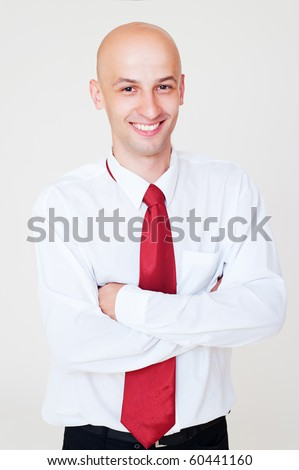 portrait of smiley handsome businessman over grey background - stock photo
