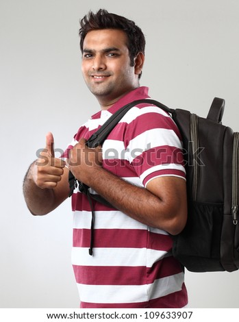 portrait of smiley student showing thumbs
