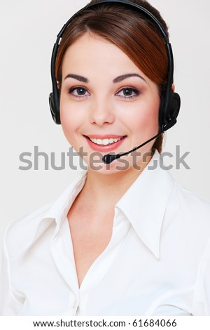 portrait of smiley telephone operator over grey background - stock photo