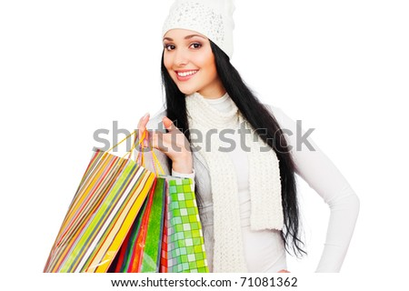portrait of smiley woman with shopping bags - stock photo