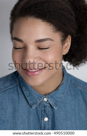 Portrait of smiling African American woman with eyes closed
