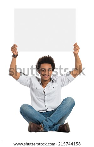 Portrait Of Smiling African Man Sitting And Showing Blank Placard Isolated On White Background - stock photo