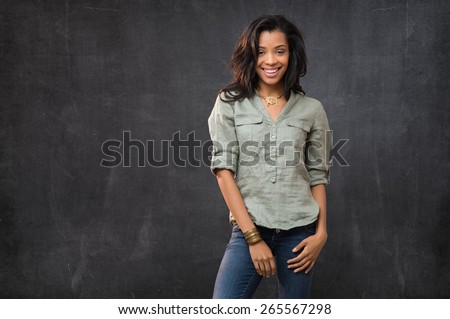 Portrait of smiling african woman looking at camera - stock photo