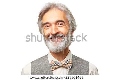 Portrait of smiling aged caucasian man with a gray beard and bowtie isolated on white background. - stock photo