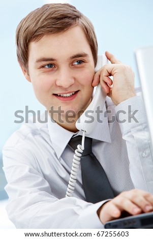 Portrait of smiling agent speaking by telephone - stock photo