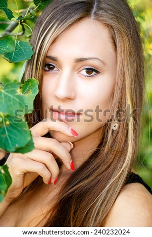 Portrait of smiling and charming lady woman girl outdoor with forrest in background  - stock photo