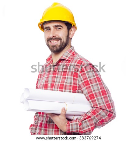 Portrait of smiling architect holding blueprints on white background