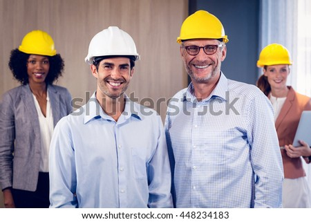 Portrait of smiling architects team standing in office