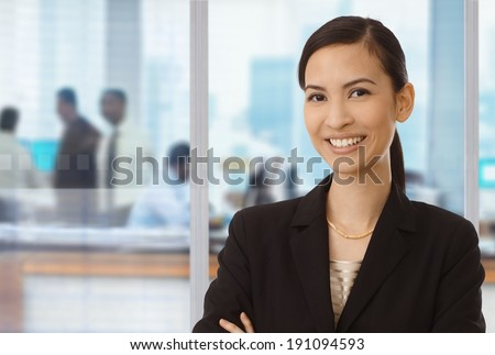 Portrait of smiling asian businesswoman in office.