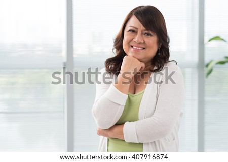 Portrait of smiling Asian Vietnamese woman - stock photo