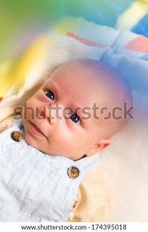 Portrait of smiling baby boy - stock photo