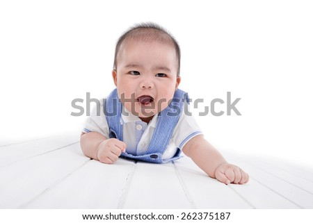 portrait of smiling baby from top